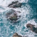 Beautiful wavy sea with cliffs at coastline in Riomaggiore, Italy