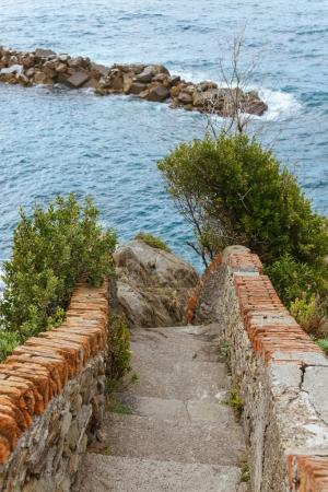 old stairs and beautiful seascape with stones in Riomaggiore, Italy