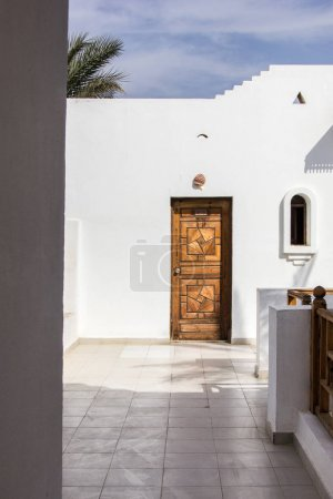 wooden door in white building at resort in Egypt
