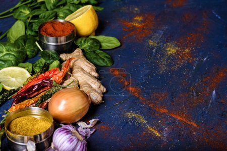 Photo for Close-up view of various spices on blue background - Royalty Free Image