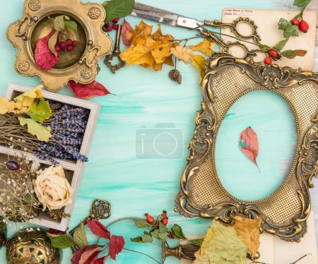 Photo for Autumn leaves and golden picture frame over bright wooden background. Scrapbook concept - Royalty Free Image