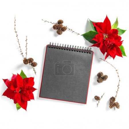 Photo for Christmas flower Poinsettia and empty sketchbook page. Floral Flat lay background - Royalty Free Image