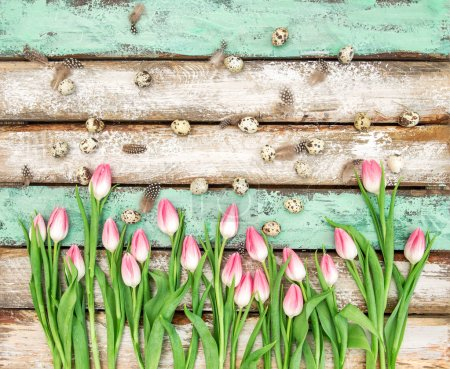 Easter decoration eggs tulip flowers wooden background