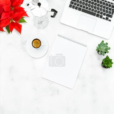 Photo for Laptop, coffee, open book and red Christmas flower poinsettia. Home office workplace. Flat lay for social media - Royalty Free Image