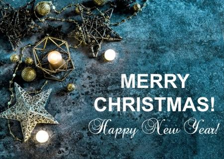 Photo for Christmas decoration stars, lights and candles. Sample text Merry Christmas Happy New Year - Royalty Free Image