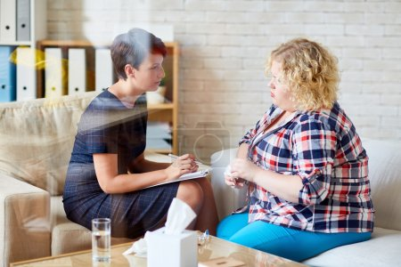 Photo for Woman with overweight and her psychologist talking about her problem - Royalty Free Image