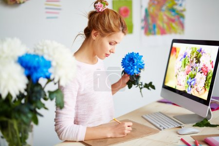 Graphic designer creating floral illustration
