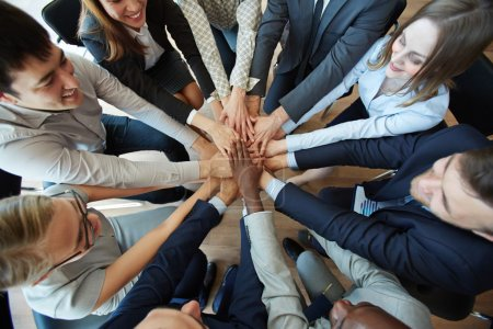Photo for Business people holding hands in circle to show their loyalty - Royalty Free Image