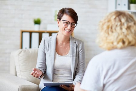 Photo for Portrait of successful psychologist talking to her patient - Royalty Free Image