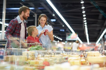 Modern family choosing products in hypermarket