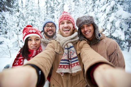 Happy people making selfie in winter