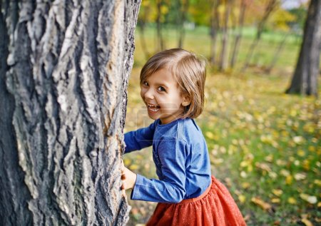 Girl Playing Hide and Seek in Park