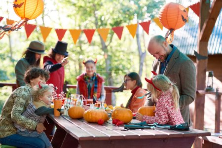 Adults and children Celebrating Halloween