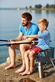 Father and son fishing at leisure