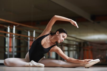 Flexible girl practicing stretching exercise