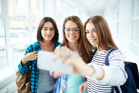 Student girls taking selfie at school