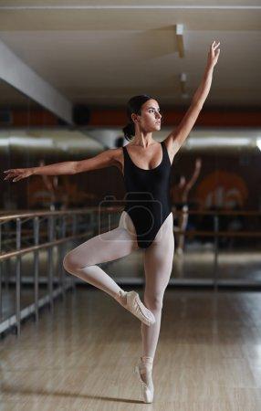 Slim girl exercising in ballet class