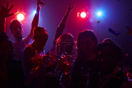 Dancers with champagne enjoying party in nightclub