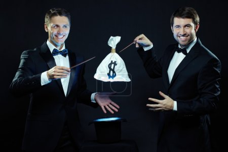 magicians taking sack with money out