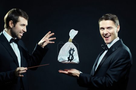 Men making trick with money