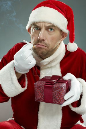 Wicked Santa Claus damaging gift boxes