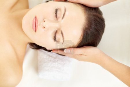 Photo for Female hands massaging head of young woman - Royalty Free Image
