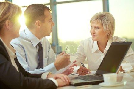 Businessman explaining his ideas to colleagues