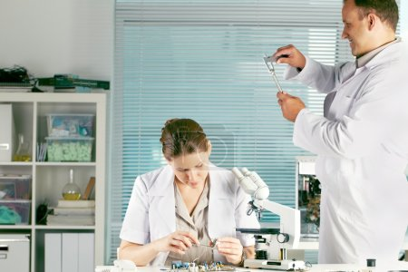 professional scientists working at the laboratory