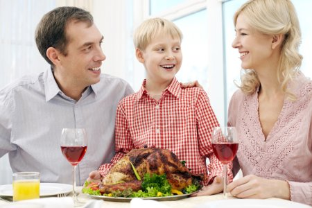 Happy family at Thanksgiving Day
