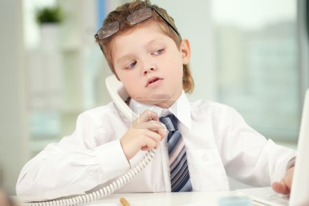 little businessman talking on the phone