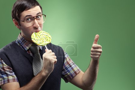 Nerd boy sucking a lollipop