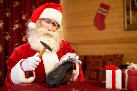 Santa Claus as a shoemaker