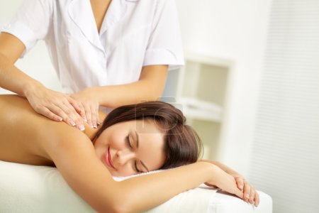 Young woman enjoying spinal massage