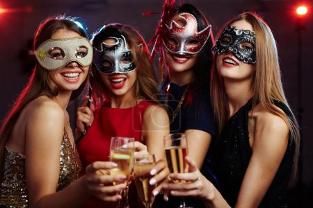 Girls toasting with champagne at party