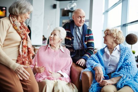 Group of aged people having conversation