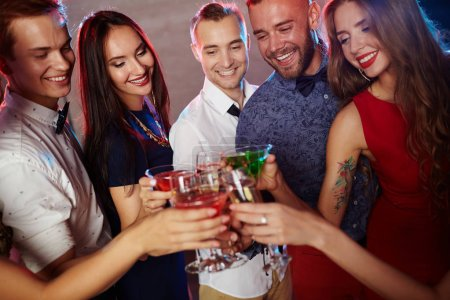friends clinking with cocktails at party