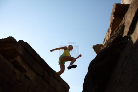 girl jumping in mountains