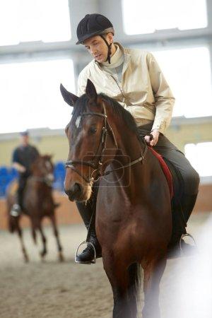 Jockey training a horse before the race
