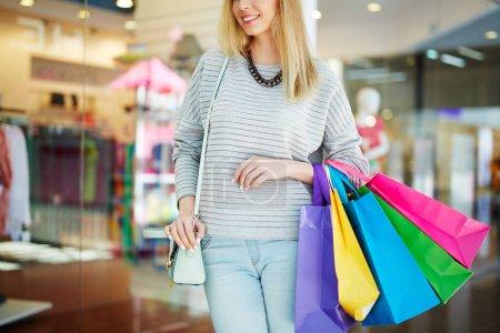 Smiling shopper in shopping center