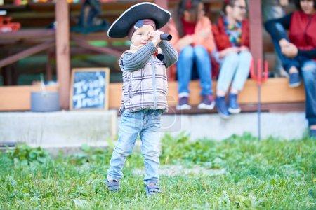 Little boy looking in binoculars
