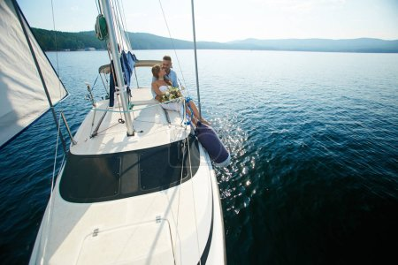 Affectionate couple traveling on yacht