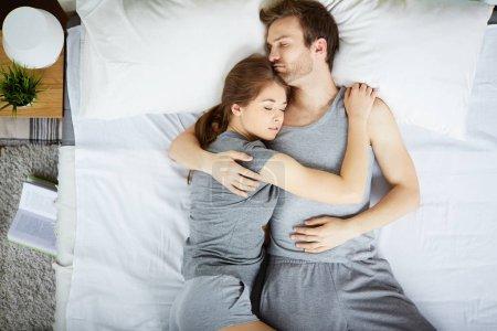 Restful couple sleeping in embrace