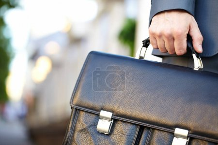 Leather briefcase held by a man