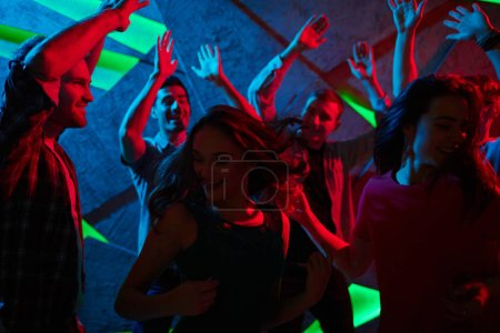 friends enjoying dance in night club
