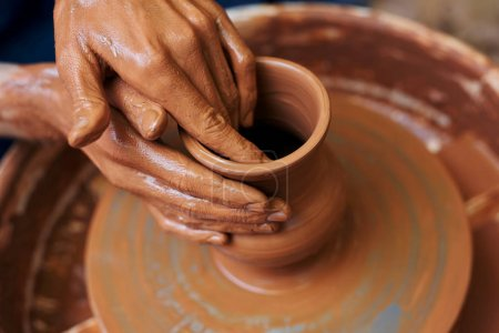 master making clay pottery