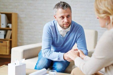 Mature man reassuring his patient after talk