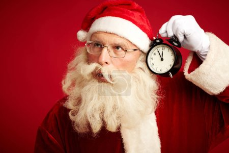 Santa Claus with alarm-clock