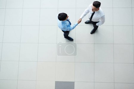 Photo for Overview of two modern agents handshaking - Royalty Free Image