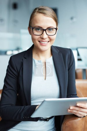 Successful woman with touchpad