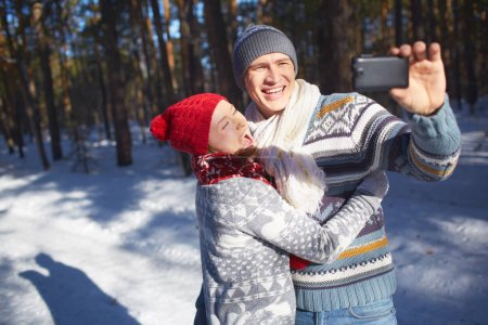 woman with her husband making selfie